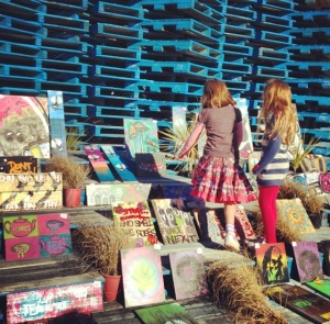 Children admire the art in a popup pallet gallery in Christchurch, New Zealand. Photo by Katie Spain